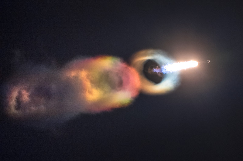 A wicked view of the Falcon 9 nearing the supersonic regime of flight, creating condensation which instantly freezes and luminesces in the rocket's brighter-than-the-sun exhaust.