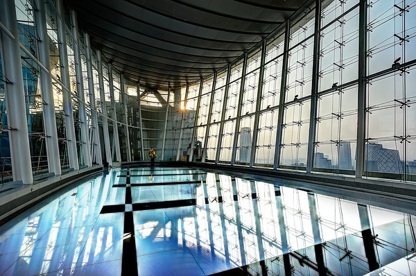 Swimming On Top of Beijing I spent the morning and the night up on top of this building shooting downtown. I didn't even realize this awesome room was here until I came down to the bathroom! So I decided to have some fun moving around and taking photos!And yes, if you look close, you can probably see it is not really a swimming pool. The floor was super-buttery and soft. I don't know what this room was used for. As far as I could tell, it was always empty. There were no tables or stage or anything at all… maybe the only reason it ever existed was for me to come in and take a photo of it!- Trey RatcliffClick here to read the rest of this post at the Stuck in Customs blog.