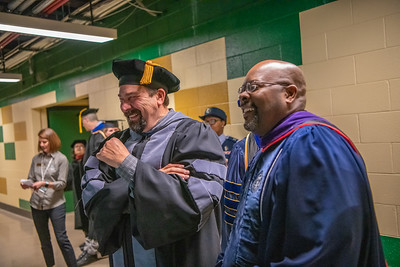 CSU President and Chancellor Tony Frank and Rico Munn, Chair of the CSU Board of Governors, share a laugh prior to the CSU College of Liberal Arts 1 commencement ceremony on Sunday, May 19, 2019, in Fort Collins, Colo.
