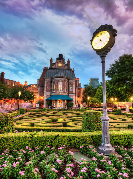 France in Epcot These little fabrications of countries around Epcot try really hard at being authentic, and they are often quite successful!  Sometimes bits and pieces here are a little cheesy, but I get the sense that the people that build, model, and landscape these things put a lot of time and effort (and love) into it.  I'm sure it gets down to the detail of trying to choose the right kind of fonts for the clock.This evening was a particularly lucky one because of the clouds and the light in the sky.  This situation is so rare that I went photo-crazy for about 15 minutes while it lasted!- Trey RatcliffClick here to read the rest of this post at the Stuck in Customs blog.