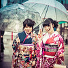 Two Traditional Japanese Women In The Rain