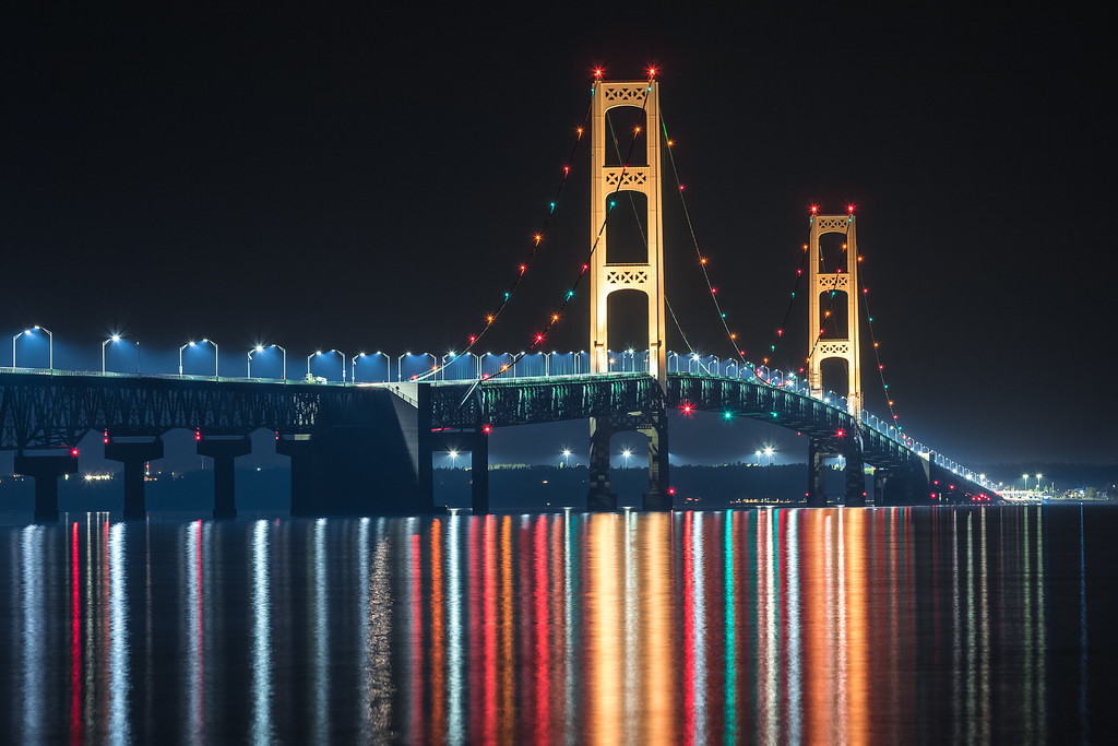 "The ""Mighty Mac""  reflecting off the straits of Mackinac at midnight."