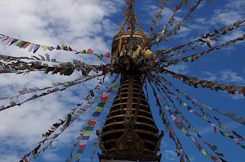 Monkey Temple, prayer flags, and blue skies, in Kathamandu, Nepal
