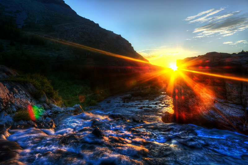 """<h2>The Morning River</h2> <br/>Did you all know I have a free <a href=""""http://www.stuckincustoms.com/stucknewsletter/"""" rel=""""nofollow"""">Newsletter</a>?  You'll love it... all kinds of great photos and free tips!<br/><br/>Here is a photo from a crisp and cool morning in Glacier National Park.  This river empties from a icy clear lake.  I was running back and forth between here and the lake as quickly as I could to get the light as it crept over the horizon.<br/><br/>Late next week I'll be taking a little photo-trip down the PCH (famous Highway 1 in California).  There's a <a href=""""http://www.readwriteweb.com/summit/"""" rel=""""nofollow"""">Real-Time Web Summit</a> in Mountain View; after that, I'm driving down to San Diego.  If any of you are going to be at the conference too, be sure to drop me a note or a tweet!<br/><br/>- Trey Ratcliff<br/><br/><a href=""""http://www.stuckincustoms.com/2009/10/11/the-morning-river/"""" rel=""""nofollow"""">Click here to read the rest of this post at the Stuck in Customs blog.</a>"""