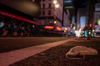 Empty city streets littered with masks, gloves, and other PPE during the peak of the COVID-19 Pandemic. 03-25-2020