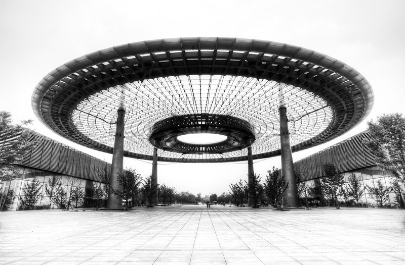 """<h2>The Mysterious UFO Device</h2> <br/>What do you think this structure is? There are almost an infinite number of possibilities.<br/><br/>I was being driven around by a very nice driver with Tom and he took me through this technology park. Most of it was rather banal, but this one structure was so unusual, I had to get out and examine it. I walked around and underneath the structure to try to figure it out. I never did, so I just set up to take a photo.<br/><br/>- Trey Ratcliff<br/><br/><a href=""""http://www.stuckincustoms.com/2013/07/05/the-mysterious-ufo-device/"""" rel=""""nofollow"""">Click here to read the rest of this post at the Stuck in Customs blog.</a>"""