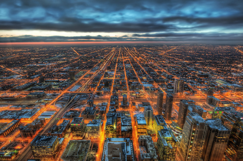Chicago Forever I took this from on top of one of the highest buildings in Chicago.  Everyone else was shooting in the other direction - towards all the big buildings.  Well, I did too to be honest... but, then I came over here... looking out this way was strangely compelling, so I decided to give it a go! :)  - Trey Ratcliff  Read more here at the Stuck in Customs blog.