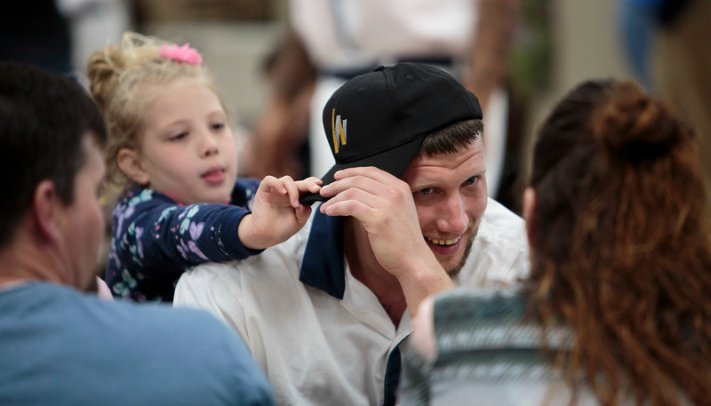 Nadav Soroker/Times-Georgian<br /> <br /> Tinsley Whited, 5, pulls a West Georgia Technical College cap onto Christopher Whited while the family visits at the graduation for GED and Welding Certificates at the Carroll County Prison, on Friday, March 29, 2019. Whited received both GED and Welding certificates.
