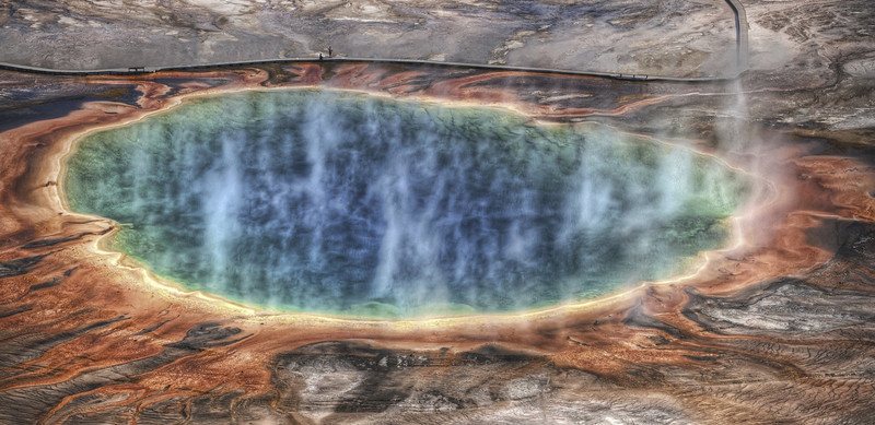 """<h2>The Grand Prismatic</h2> <br/>This place is awesome and huge.  Want to know how huge?  Look at those people standing there on the boardwalk towards the top.  Amazing, eh? <br/><br/>Getting this shot (and all my others!) was no cake walk!  But I am happy with the way it turned out.  One thing you don't see in the video is how dirty I got on the way down the mountain when I decided to take a """"short cut"""".  It was a bad idea for both me and my jeans.<br/><br/>- Trey Ratcliff<br/><br/><a href=""""http://www.stuckincustoms.com/2009/12/15/the-grand-prismatic-and-a-new-video/"""" rel=""""nofollow"""">Click here to read the rest of this post at the Stuck in Customs blog.</a>"""