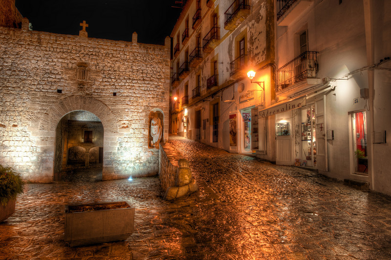 """<h2>Exploring Ibiza at Night</h2> <br/>The old medieval town of Ibiza is an awesome place for exploration at night.  Every nook, cranny, alley, and cobblestone street was built for photography.  And it was doubly-awesome after a little rain gave everything a reflective sheen.<br/><br/>After we finished dinner, we started the long walk back to the hotel.  It took 10x as long as normal with all the stops along the way.  But comon... how can you walk past something like this and <em>not</em> take a photo?   <em>Impossible</em>!<br/><br/>- Trey Ratcliff<br/><br/><a href=""""http://www.stuckincustoms.com/2011/04/10/exploring-ibiza-at-night/"""" rel=""""nofollow"""">Click here to read the rest of this post at the Stuck in Customs blog.</a>"""