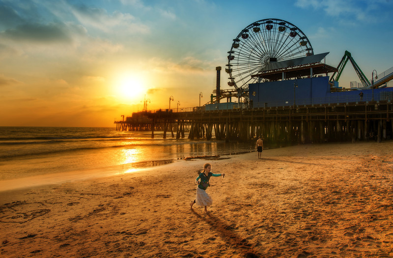 "<h2>Girl Running in Santa Monica</h2> This is the first photo I got during the LA PhotoWalk. After I was on the steps and gave my little speech-thing, I went down right to the water's edge to see what I could find. This little girl was running up the beach to her dad, so I grabbed a quick one while I talked through the shot for the crowd. I'm pretty happy with the way it turned out, since everything was unplanned.<br/><br/>- Trey Ratcliff<br/><br/><a href=""http://www.stuckincustoms.com/2012/04/02/girl-running-in-santa-monica/"" rel=""nofollow"">Read the entire post at the Stuck in Customs blog.</a>"