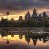 """<h2>The Lotus Sunrise</h2> <br/>These delicate shapes are seen on a variety of temples all over southeast Asia, India, and other parts of the Far East.  It is the shape of a Lotus Blossom, a timeless symbol, and it is repeated over and over here at Angkor Wat.  The lotus represents the purity of body, speech, and mind.  Like the lotus, these should float above the muddy waters of attachment and desire.  The shot was taken around 5 or 6 AM in the morning.  While shooting, I was attended to by a small Cambodian girl that would bring me strong Vietnamese coffee whenever I ran out, which was often.  I don't know where she would go to get it -- she would disappear off into the jungle and come walking calmly back every 15 minutes or so, smiling.<br/><br/> - Trey Ratcliff <br/><br/>Read more, including some info on my upcoming London photowalk (and vote on some locations for shots!) <a href=""""http://www.stuckincustoms.com/2010/08/20/best-photos-london/"""">here</a> at the Stuck in Customs blog."""