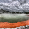 "<h2>The Artist's Palette in Rotorua</h2> <br/>Isn't this spot awesome?  I did not expect all this geothermal activity in New Zealand -- it was just as impressive as Yellowstone. <br/><br/>This area of the north island is called Rotorua.  This, specifically is the Champagne Pool at the Artist's Palette at the Wai-o-tapu Thermal Wonderland.  The term ""Wonderland"" always makes me think of a cheap attraction on the side of the road where you can buy rubber snakes after the kids have had a great time and the parents are bored out of their skulls.  But this Wonderland really was a Wonderland for all ages!  I made a few videos here as well... I need to get around to editing these things together for y'all!<br/><br/>- Trey Ratcliff<br/><br/><a href=""http://www.stuckincustoms.com/2010/04/08/champagne-pool/"" rel=""nofollow"">Click here to read the rest of this post at the Stuck in Customs blog.</a>"