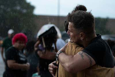 David Flores, left, is embraced in the rain at the vigil for Sincere Ash at Lane Tech College Prep on August 9, 2018 in Chicago, IL. | Colin Boyle/Sun-Times