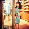 Little Girl Guarding A Store In Beijing