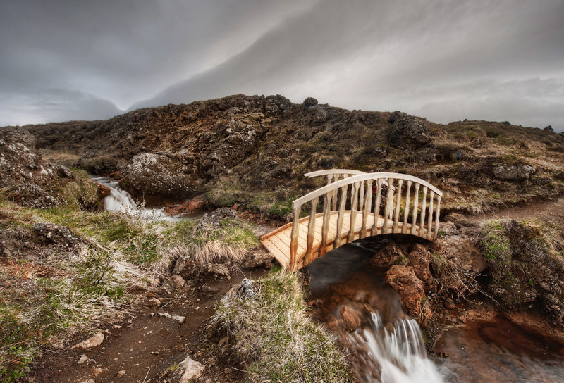 """<h2>Bridge of the Dark Fairy</h2> Now this place was hard to find.  In fact, I tried to geo-locate it after the fact, and I could not even come close.  It's like one of those lost spots on earth, like the island with King Kong, or the deep paths to Silfen worlds...  After leaving the road, I scrambled down a few hillocks and walked along the stream a bit.  Finding this quite mirror-world of sorts, I stopped for a photo.   - Trey Ratcliff  Read all about this and my 1-hour midlife crisis <a href=""""http://www.stuckincustoms.com/2011/07/07/im-40/"""">here</a> at the Stuck in Customs blog."""