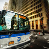 "<h2>New York City Bus</h2> <br/>Here's one of the first places I stopped during the New York City photowalk. Since I'm not from NYC, I really get excited about all these thing New Yorkers find quite banal. But I saw that big glass surface and all the reflections, so I got in close with the 14-24mm. I had to be fast… these busses don't wait too long. I was never tempted to actually get in FRONT of the bus, however. I may not be from NYC, but I don't have a deathwish while taking photos there! :)<br/><br/>- Trey Ratcliff<br/><br/><a href=""http://www.stuckincustoms.com/2013/03/17/new-york-city-bus/"" rel=""nofollow"">Click here to read the rest of this post at the Stuck in Customs blog.</a>"
