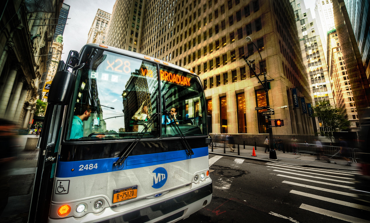 New York City Bus Here's one of the first places I stopped during the New York City photowalk. Since I'm not from NYC, I really get excited about all these thing New Yorkers find quite banal. But I saw that big glass surface and all the reflections, so I got in close with the 14-24mm. I had to be fast… these busses don't wait too long. I was never tempted to actually get in FRONT of the bus, however. I may not be from NYC, but I don't have a deathwish while taking photos there! :)- Trey RatcliffClick here to read the rest of this post at the Stuck in Customs blog.