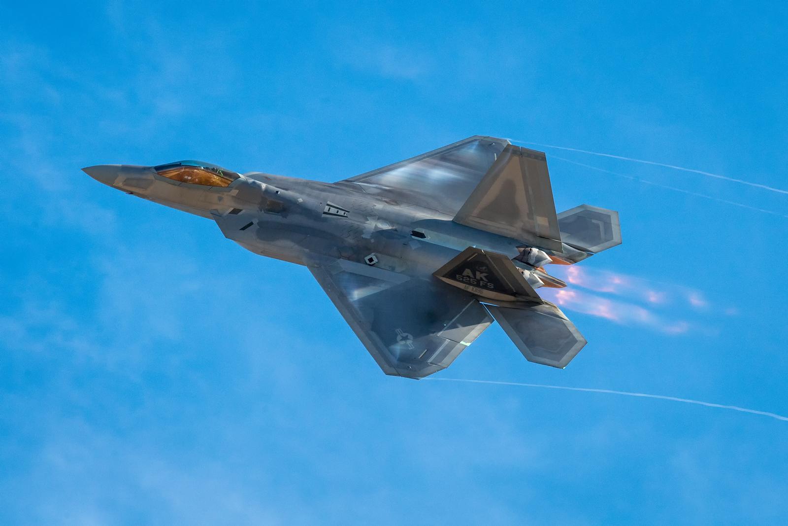 F-22 Raptor accelerating past the flight line