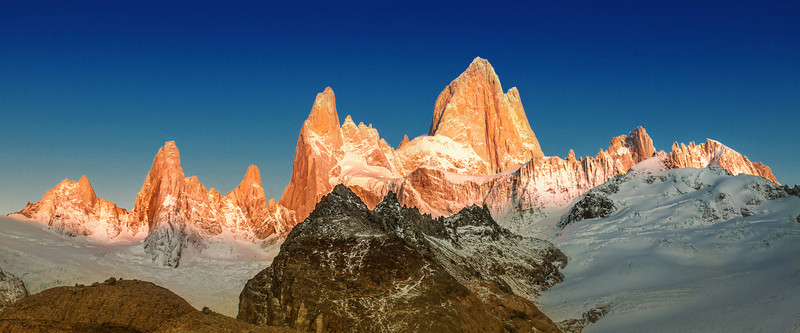 "<h2>The Deep Blue Morning at Cerro Torre</h2> <br/>I'd love to return to this place, but I'm afraid the weather would not be as clear and perfect.  Many locals told me there is a 90% chance that these mighty peaks would be covered with clouds, so I felt very lucky to have everything so perfect.  Surely, a return here would not be nearly as good…  but maybe… just maybe… a return would have clouds, but in an awesome dramatic way.<br/><br/>You probably also know I'm not a fan of plain blue skies.  But way up in the mountains, sometimes the sky on the opposite side of the sun is a deep atmospheric blue.  I see it from planes a lot when dawn breaks.  Maybe you have seen that color of blue too… and here it is again.<br/><br/>- Trey Ratcliff<br/><br/><a href=""http://www.stuckincustoms.com/2012/01/28/cerro-torre/"" rel=""nofollow"">Click here to read the rest of this post at the Stuck in Customs blog.</a>"