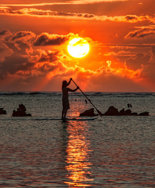 "<h2>Paddleboard in Hawaii</h2> The weather in Hawaii was rather dour and dismal for most of my trip. I only caught one sunset while there, so I decided to try to make the most of it.<br/><br/>This lone paddleboarder was skating across the surface of the ocean while I was walking along the beach. Although this photo looks fairly serene and calm, I was not. You only get one chance for this shot, unless you are willing to take a shot, sprint, take a shot, sprint, take a shot, SPRINT, etc. I'm sure people on the beach thought I was a loon, but I couldn't think of any other way to get it done!<br/><br/>- Trey Ratcliff<br/><br/><a href=""http://www.stuckincustoms.com/2012/04/11/paddleboard-in-hawaii/"" rel=""nofollow"">Read the rest of this post at the Stuck in Customs blog.</a>"
