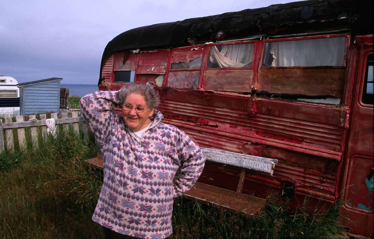 I met Genevieve when out for a walk one afternoon. She is standing next to the old red school bus that was her summer home until it was vandalized. She and her husband, Hadley, a fisherman, then moved into a more modern trailer. They grow a garden here and like to get out of town (Bonavista) even though it's just a few minutes drive away.