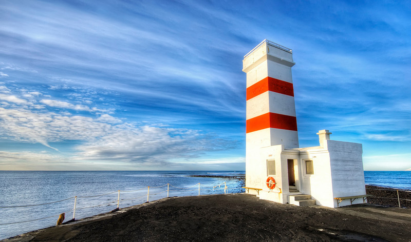 """<h2>Alone in Winter, Against the World... </h2> <br/>This is one desolate place.<br/><br/>It's the southern coast of Iceland where the sea and the wind were absolutely ripping their way past me and the lighthouse.  I always imagine what it is like to be inside of one of those lighthouses, all night long through the winter.  I can't even envision what that would be like, and after only a short time there in the icy wind, I got the willies and was happy to get out of there.<br/><br/>- Trey Ratcliff<br/><br/><a href=""""http://www.stuckincustoms.com/2008/12/20/alone-in-winter-against-the-world-and-i-am-selling-my-camera-on-ebay/"""" rel=""""nofollow"""">Click here to read the rest of this post at the Stuck in Customs blog.</a>"""