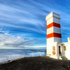 "<h2>Alone in Winter, Against the World... </h2> <br/>This is one desolate place.<br/><br/>It's the southern coast of Iceland where the sea and the wind were absolutely ripping their way past me and the lighthouse.  I always imagine what it is like to be inside of one of those lighthouses, all night long through the winter.  I can't even envision what that would be like, and after only a short time there in the icy wind, I got the willies and was happy to get out of there.<br/><br/>- Trey Ratcliff<br/><br/><a href=""http://www.stuckincustoms.com/2008/12/20/alone-in-winter-against-the-world-and-i-am-selling-my-camera-on-ebay/"" rel=""nofollow"">Click here to read the rest of this post at the Stuck in Customs blog.</a>"