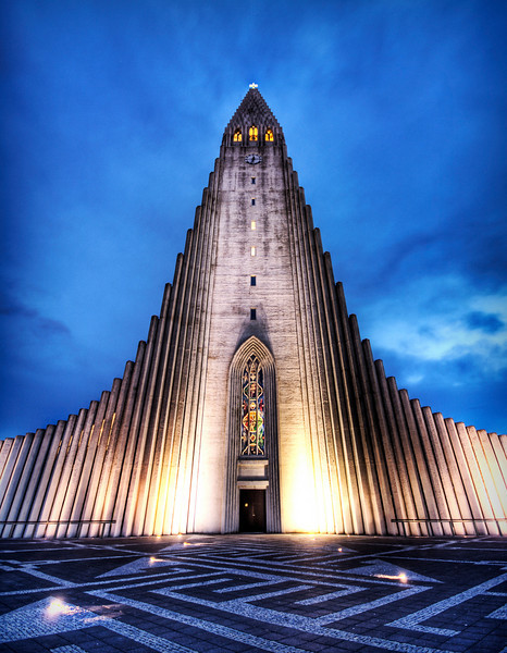 The Wrath of the Norse Gods Hewn from stone, the temple spire awaits my approach, making my chest rattle with thunder.This is Hallgrímskirkja, a church in downtown Reykjavik, Iceland.  It is built to resemble an ancient area of the countryside, near a waterfall, where stones in these shapes were found as part of a natural geological formation.- Trey RatcliffClick here to read the rest of this post at the Stuck in Customs blog.