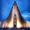 "<h2>The Wrath of the Norse Gods</h2> <br/>Hewn from stone, the temple spire awaits my approach, making my chest rattle with thunder.<br/><br/>This is Hallgrímskirkja, a church in downtown Reykjavik, Iceland.  It is built to resemble an ancient area of the countryside, near a waterfall, where stones in these shapes were found as part of a natural geological formation.<br/><br/>- Trey Ratcliff<br/><br/><a href=""http://www.stuckincustoms.com/2007/02/14/the-wrath-of-the-norse-gods/"" rel=""nofollow"">Click here to read the rest of this post at the Stuck in Customs blog.</a>"