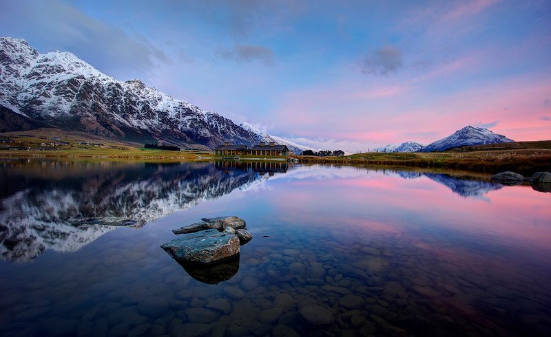 Jack's Point in Queenstown I went out with Eden Brackstone the other night to take some photos. After he decided to wade callously into this crystal clear water and ruin the placid reflection, I had about five minutes to contemplate life while the ripples settled down. And then I took this one!Man, I do love this Sony NEX-7. And no, Sony didn't pay me to say that or give me my camera…- Trey RatcliffClick here to read the rest of this post at the Stuck in Customs blog.