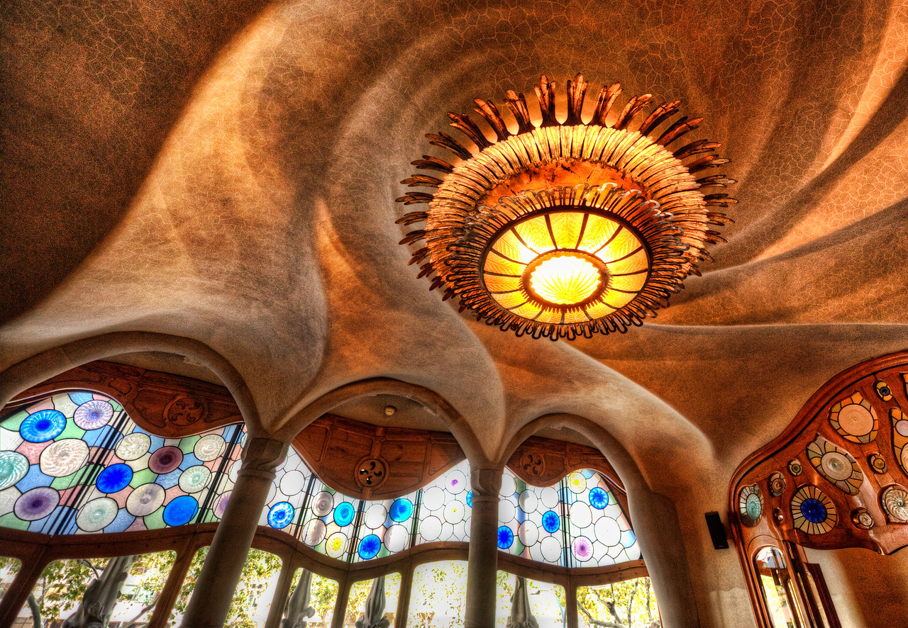 """The Gaudi Cheesecake Factory I was stuck doing handheld shots all over this awesome Gaudi house because the PR staff would not let me use a tripod.  They also said I was not allowed to post any photos of the house on my blog.  I told them this was absolutely ridiculous and of course I would post photos on the blog.  They said it was not ridiculous and I should really listen.  I then said, """"But everyone else is here taking photos and posting on Facebook and Flickr!, right?""""  And they said, """"Oh, well, they shouldn't be doing that either.""""Anyway, I just don't deal well with that kind of insanity... I found this place to be quite beautiful, and I wanted to share it with you anyway.  If you want to see it yourself, visit the Casa Bastilo in Barcelona.  Oh, I know.... PR team at Gaudi... this is so terrible... #1 Travel Blog in the world showing a beautiful photo of your property and encouraging people to go...  This really is as horrible as you imagined. - Trey Ratcliff Read more here at stuckincustoms.com."""