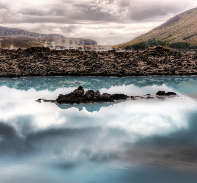 "<h2>When the Earth was Young</h2> <br/>This unique area of Iceland has new surprises at every turn. <br/><br/>The strange milky-blue water boils up from underground. There is a big part of you that wants to touch it to see how hot is is. The other part of you is scared to touch it. These two parts never stop fighting until you go ahead and touch it. Then, you discover it's not all that hot after all, and it only reinforces a already poorly-reinforced decision matrix for the next time. <br/><br/>- Trey Ratcliff<br/><br/><a href=""http://www.stuckincustoms.com/2010/09/06/when-the-earth-was-young/"" rel=""nofollow"">Click here to read the rest of this post at the Stuck in Customs blog.</a>"