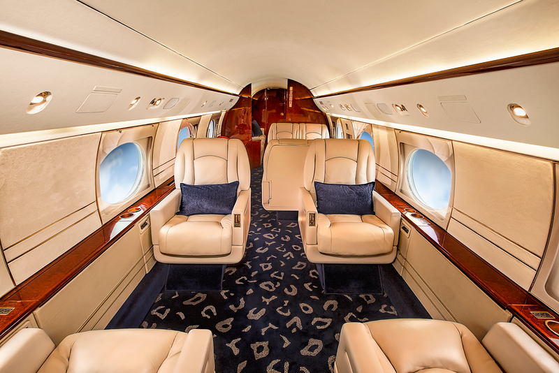 We work hard to ensure that the frame and staging of each photo showcases space, comfort, amenities and finishes of each and every aircraft. Notice the simple warmth and comfort conveyed by this deceptively simple photo and how the window scenery lends to an in-flight feeling.