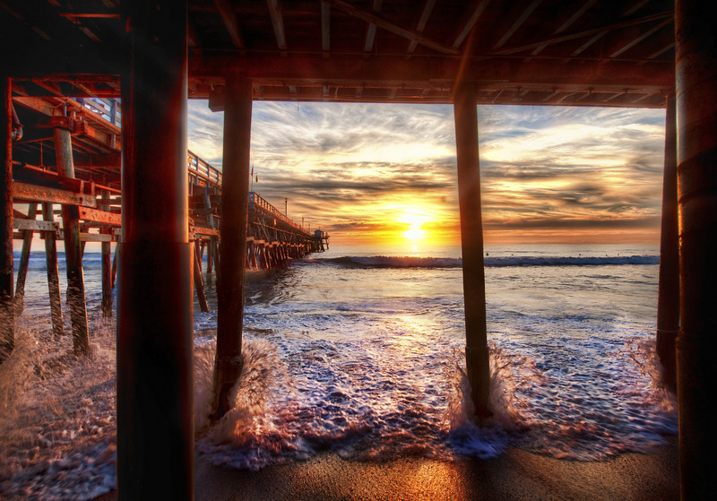 """<h2>Under the Docks in California</h2> <br/>Some of you remember the <a rel=""""nofollow"""" href=""""http://www.stuckincustoms.com/category/travel/california/san-clemente/"""">great photowalk we had down in San Clemente</a>.  I really had a good time there.  On my photowalks, typically I stop from time to time and tell the assembled crowd what I am doing.  Well, I finally got a chance to process this quintet!<br/><br/>I felt fortunate to have a good friend that had an amazing condo that overlooked this same beach.  Frankly, after a long day and night of shooting, I felt spoiled and happy just taking a few more steps to my pad...  grabbing some cool drinks... opening the patio doors to listen to the surf... good times!<br/><br/>- Trey Ratcliff<br/><br/><a href=""""http://www.stuckincustoms.com/2010/05/05/under-the-docks-in-california/"""" rel=""""nofollow"""">Click here to read the rest of this post at the Stuck in Customs blog.</a>"""