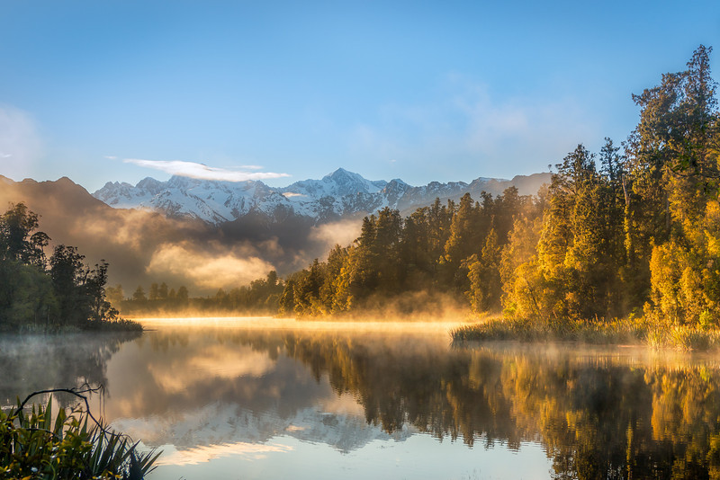 "Lake Matheson on the South Island of New Zealand offers an exceptional view of Mount Cook reflecting in the water. And if you get up early, the water is completely still. If you ever go to Fox Glacier and stay for the night, do yourself the favor and get up early to see this. Photo by: Jacob Surland,  <a href=""http://www.caughtinpixels.com"">http://www.caughtinpixels.com</a>"