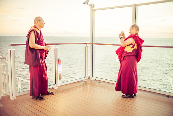Monks Taking Mobile Photos On A Cruise