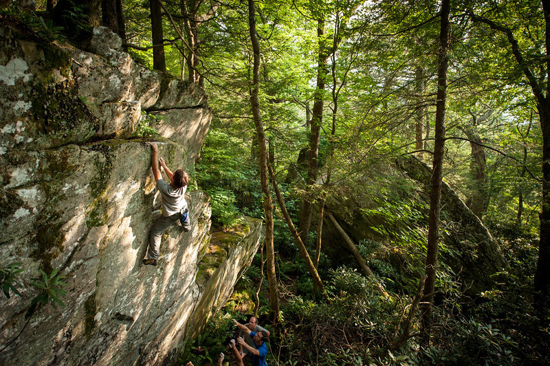 Eric Crews climbing an obscure line at Grandmother Mountain boulders near Boone, North Carolina.