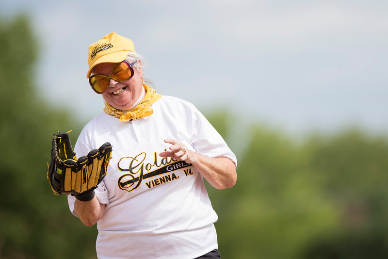 On July 8, 2015 at the National Senior Games Association competition, Charly Neill-Roe is the getting ready to pitch for the Golden Girls against the Kentucky Classics in a game of softball at Eagan Park, Minn. (© Erica Jacques 2015)