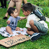 John Chaides / Courier<br /> Damion Carballo, 4, and Lorenzo Anaya, 6 months, are sitting down at a DACA march that ended to Los Angeles City Hall on Tuesday, September 4, 2017.