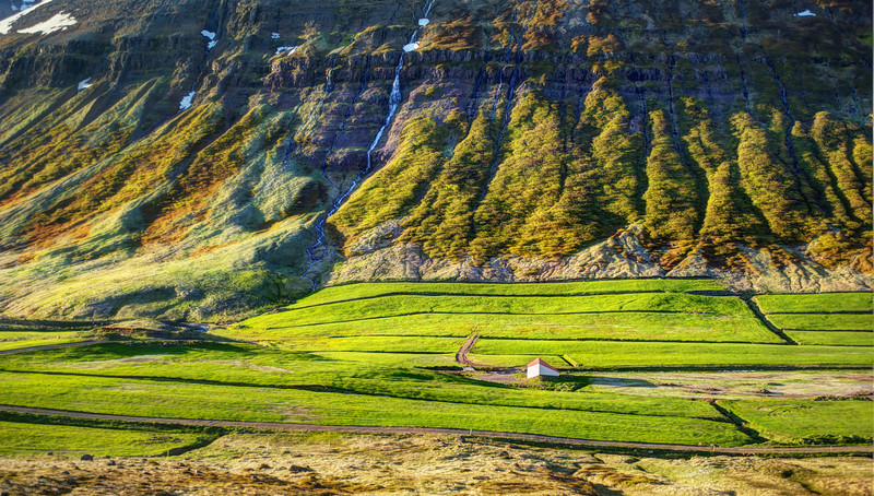 "<h2>Farm in the Vastness</h2> <br/>When you drive across Iceland, scene after scene is soooo…. epic! You just get this feeling of a vastness that permeates everything. There is a kind of timelessness in the architecture too, like you are unsure if something is new or quite old.<br/><br/>I felt this way when I passed through this valley full of farms with a little farmhouse right in the middle.<br/><br/>- Trey Ratcliff<br/><br/><a href=""http://www.stuckincustoms.com/2012/08/26/farm-in-the-vastness/"" rel=""nofollow"">Click here to read the entire post at the Stuck in Customs blog.</a>"