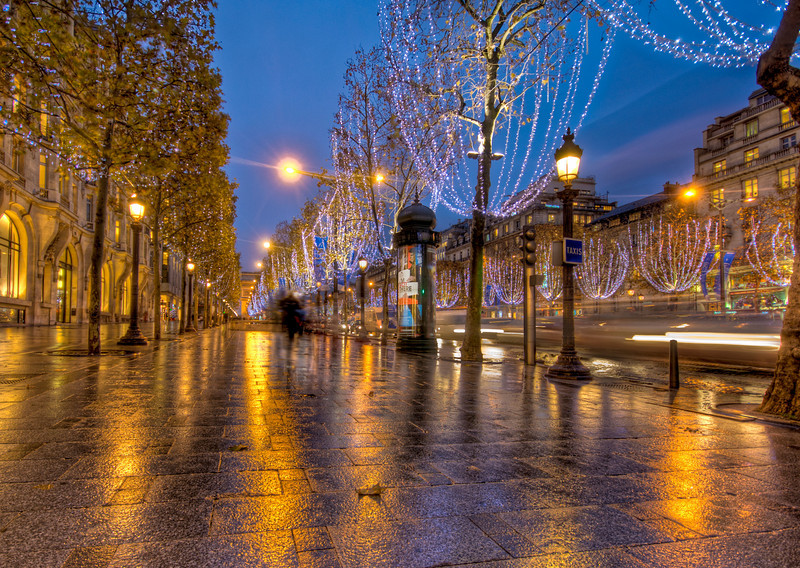"<h2>Christmas on the Avenue des Champs-Élysées</h2> <br/>This is one of the most famous streets in the world, so I wanted to do my best to capture it in as romantic a way as possible.  The time of day usually does a lot to affect the mood, and these classical places (especially in Paris) are often better to shoot in the evening or night.  The dusk light is different than the morning light.  And, frankly, it's easier to stay up past sunset than it is to wake up before the sun rises.<br/><br/>I love how these cities put up lights on the trees.  I wish all cities would do this at night.  Some people complain about ""light pollution"", but photographers won't!<br/><br/>Trey's Tip: While I don't mind making a busy street look hectic with the hustle and bustle of little ants marching, in this case, I wanted it to look fairly empty. The two ways to do this are to shoot at a high f-stop or to shoot when it is raining and people don't walk on the streets. This is the latter case.  Normally, in an HDR, the rain does not show up – just the nice reflective wetness that stays behind.<br/><br/>- Trey Ratcliff<br/><br/><a href=""http://www.stuckincustoms.com/2007/11/29/christmas-on-the-champs-elysees/"" rel=""nofollow"">Click here to read the rest of this post at the Stuck in Customs blog.</a>"