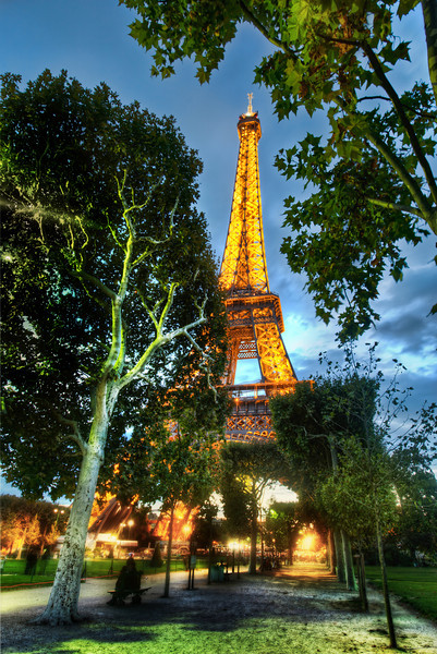 """<h2>Walking to Dinner in Paris</h2> Today's photo is another one processed during the new <a href=""""http://www.stuckincustoms.com/hdr-video-tutorial/"""">HDR Video Tutorial</a>.  When I go to take photos of famous places, I follow sort of a star-pattern.  Maybe it's more of a devilish inverted pentagram, but you get the idea...  It's really hard to imagine how it would look from various compositions, so walking around it...getting closer and getting further... these can help give me idea.  After outings like this, I like to find little restaurants where no one speaks English.  Even though I speak a little French, I still have no idea what I'm ordering...  Understanding the intricacies of French menus is a whole new level of confusion.  But, it gives you a chance to look blankly at the waiter and say, """"Surprise me!""""  - Trey Ratcliff  Read more <a href=""""http://www.stuckincustoms.com/2011/06/11/top-500px-photographers/"""">here</a> at the Stuck in Customs blog."""