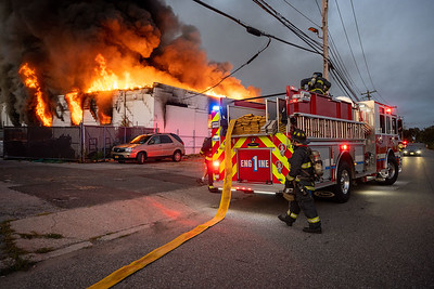 Firefighters from the East Farmingdale Fire Company arrive at a fully involved commercial fire. 09-08-2020