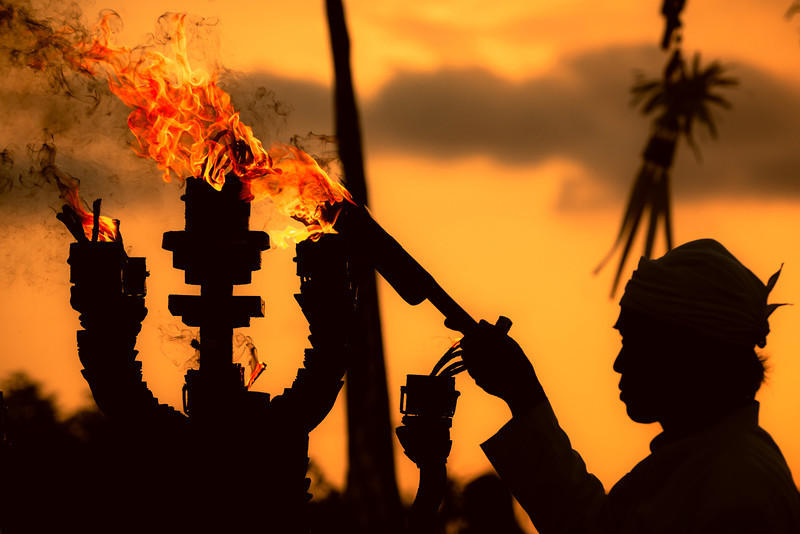 "<h2>Kecak Dance Ceremony</h2> <p>The priest of the Kecak Dance begins with an opening ceremony. He lights the fire and splashes the dancers with water.</p>  <p>See this photo at <a href=""http://alikgriffin.com"">AlikGriffin.com</a></p>"