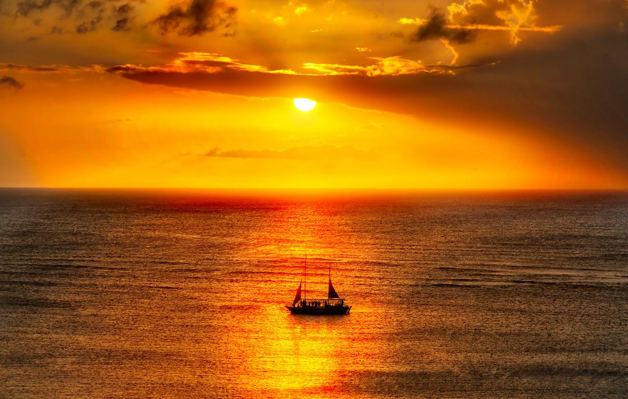 Ship Sailing At Sunset In Aruba