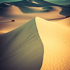 "<h2>An Endless Desert</h2> <br/>This was my first trip to a proper desert. It's the kind of desert that I imagined after watching Lawrence of Arabia countless times (it's one of my favorite movies). Getting up and down these dunes in the middle of a hot summer day is enough to make you collapse. I think I lost one liter of water per dune.<br/><br/>After a while, I started to find it a little easier to walk around once I could better predict the hard parts and soft parts of the sand. But, by then, I had already made all my mistakes and my shoes were completely full of sand. Trudging around with 15 lb feet makes the effort across the dunes extra-special.<br/><br/>- Trey Ratcliff<br/><br/><a href=""http://www.stuckincustoms.com/2012/10/01/an-endless-desert/"" rel=""nofollow"">Click here to read the rest of this post at the Stuck in Customs blog.</a>"