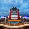 "<h2>On Top of the Disney Fantasy</h2> <br/>This was my first Disney cruise, so I don't know if I was lucky with the clouds, or if they are usually full of oceanic-drama. I know some of you in the audience are big ocean-sailing-boat people, so you would know… <br/><br/>What you see here is one of the ""Adult Only"" areas of the ship. I was surprised that there were many of these areas spread around, and at least three pools just for grown-ups. It was a nice surprise! <br/><br/>- Trey Ratcliff<br/><br/><a href=""http://www.stuckincustoms.com/2012/12/21/the-light-camera-mark-i/"" rel=""nofollow"">Click here to read the rest of this post at the Stuck in Customs blog.</a>"