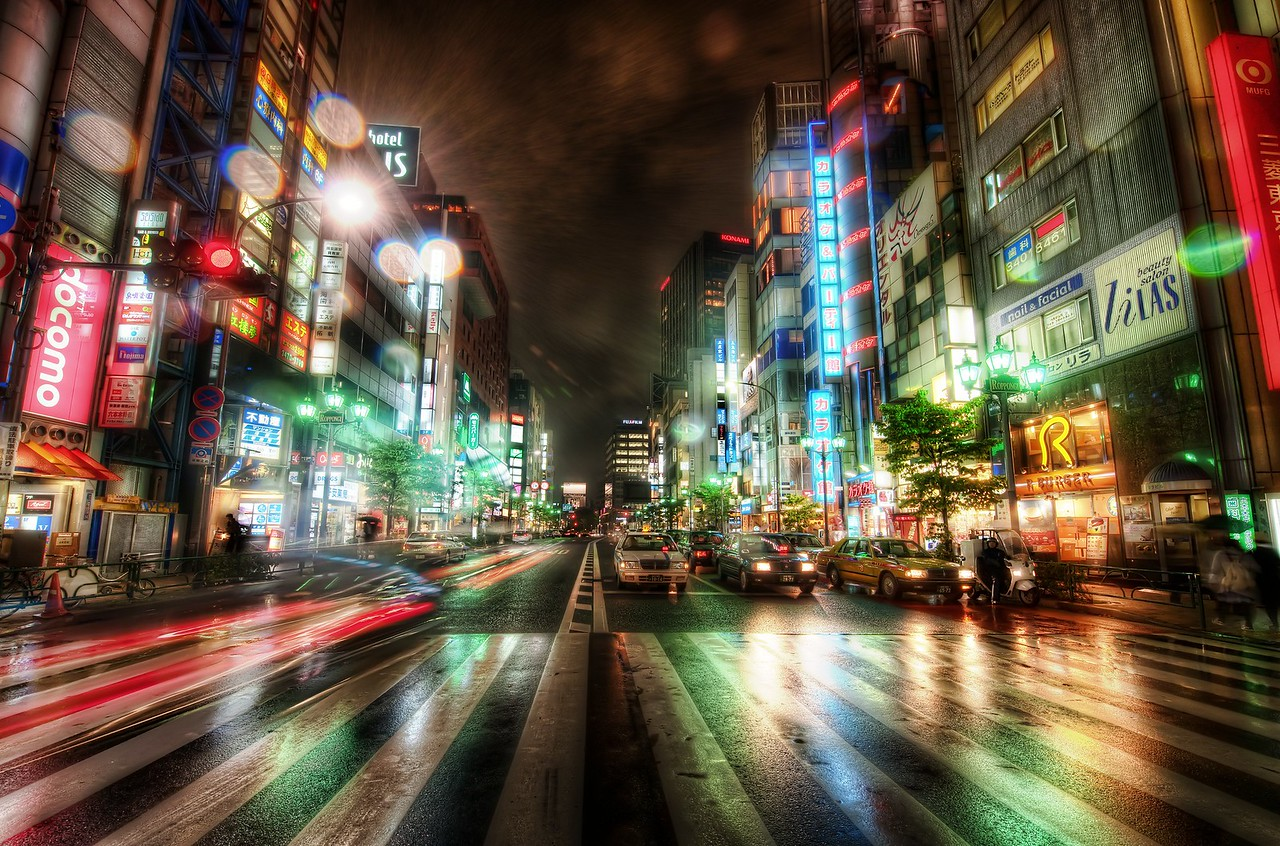 Ripping Through the City Streets of Tokyo This photo was taken on my final night in Tokyo.  It was rainy, cool, and perfect for street photography.  It's hard to explain HOW clean my sensor was in this photo.  I had the privilege of taking it to the Nikon Headquarters in Tokyo and having the sensor cleaned by a real Japanese guy.  It was a religious experience -- and it only cost $10!  What a deal!- Trey RatcliffClick here to read the rest of this post at the Stuck in Customs blog.