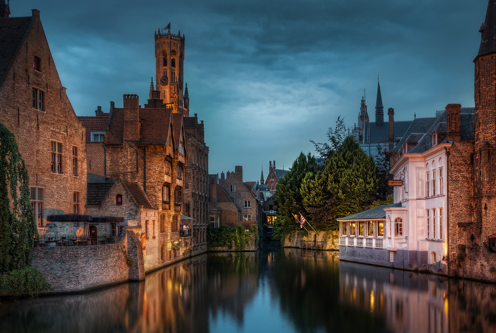 "Canal in old Middle ages town. ""In Bruges"" is the name of a movie. It refers to the old middle age town of Bruge in Belgium. Along with Amsterdam it's called the Venice of the north and it is. Photo by Jacob Surland,  <a href=""http://www.caughtinpixels.com"">http://www.caughtinpixels.com</a>."